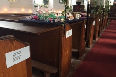 In 1818 the parishioners were invited to 'take their pews' and their names and the quarterlands and common land they farmed are shown on their allocated pews (courtesy of Sandra Kerrison)