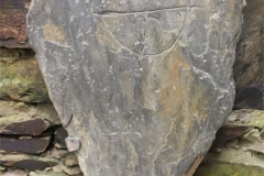 This roughly triangular slab was found while ploughing on Baroose Farm in 1959